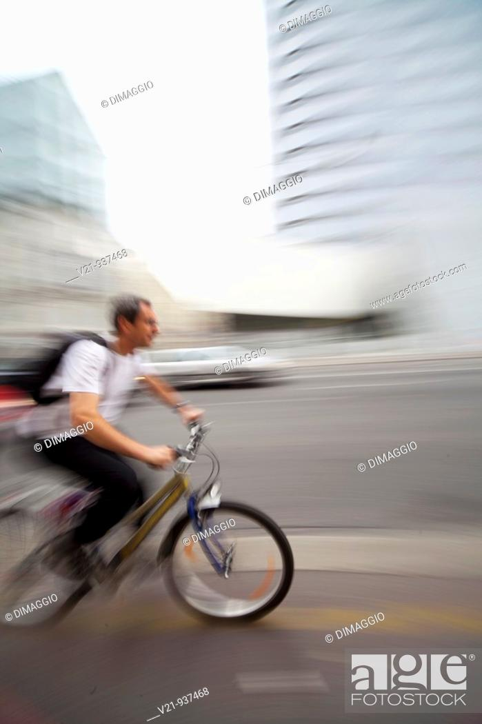 Stock Photo: Male riding bicycle in city to destination  Vienna, Austria.