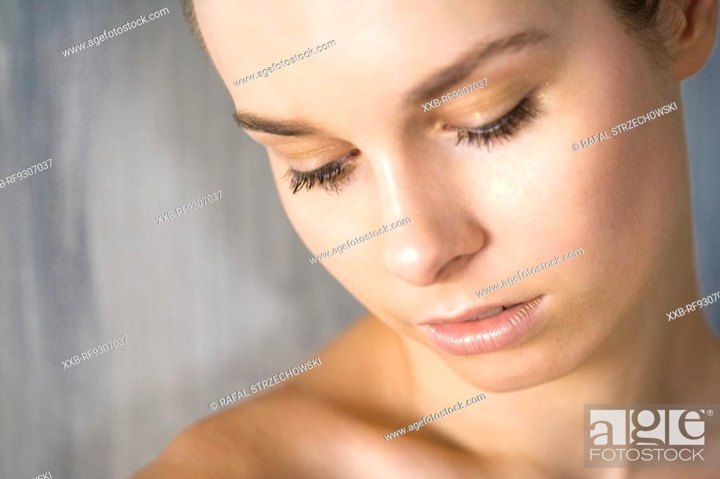 Stock Photo: woman in glod make up.