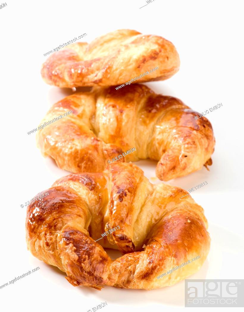 Photo de stock: fresh croissants with honey coverage.