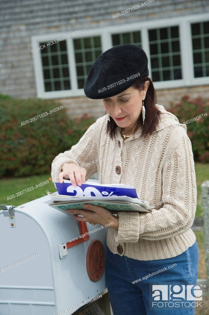 Stock Photo: Mature woman checking mails.