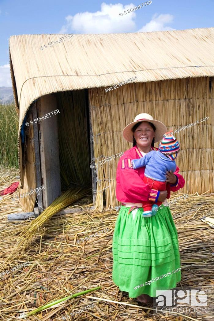Uro Woman With Child In Front Of A Reed Hut Peru Titicaca Puno