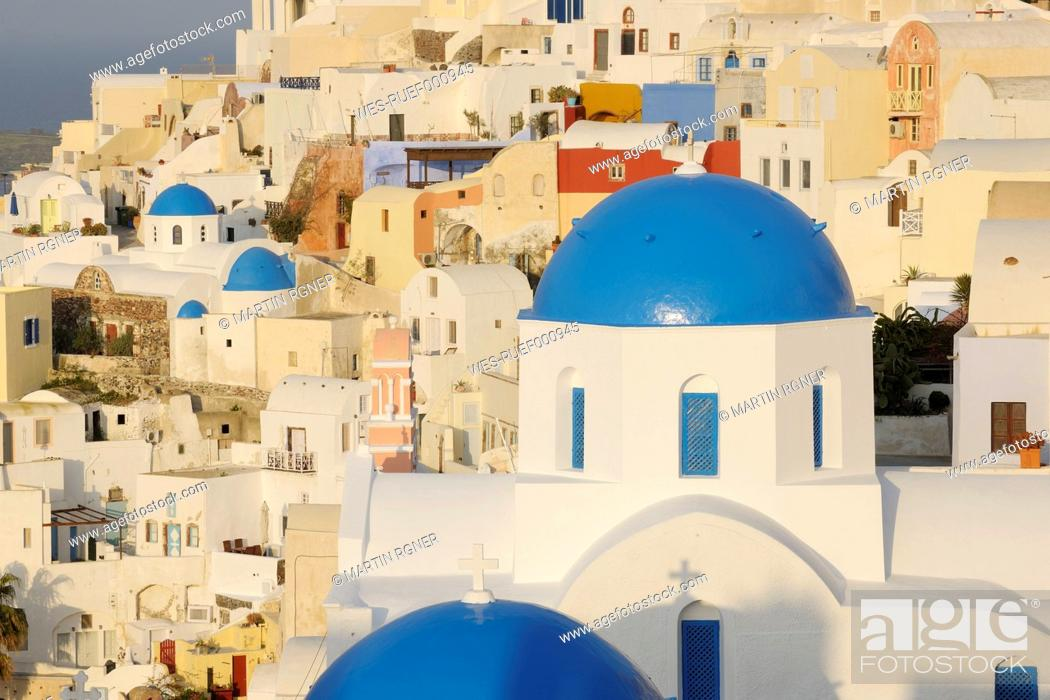 Stock Photo: Greece, View of classical whitewashed church at Oia village.