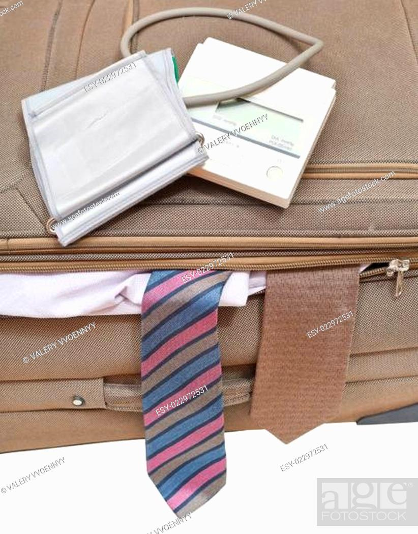 Stock Photo: above view of sphygmometer on suitcase with ties.