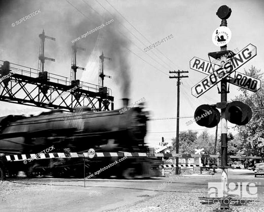 Stock Photo: Railroad crossing sign at the railroad crossing.