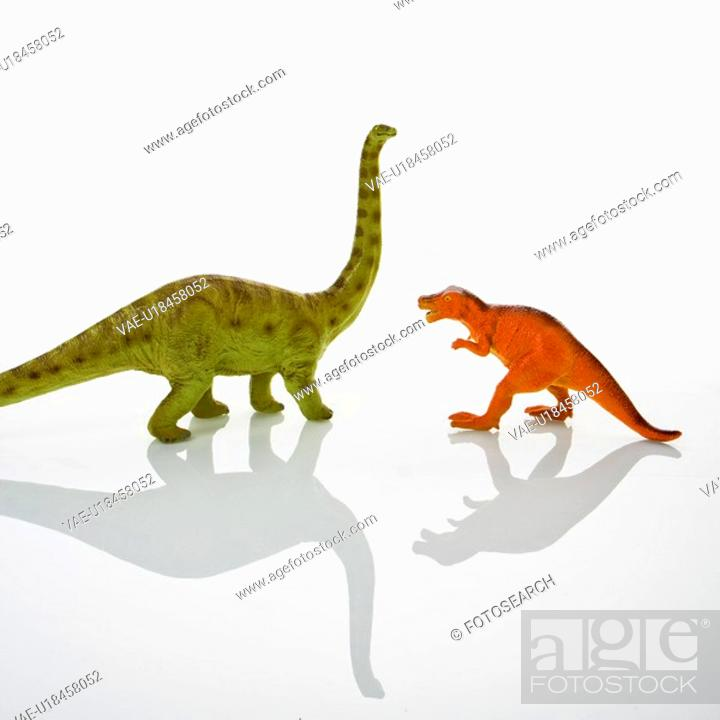 Stock Photo: Plastic toy Tyrannosaurus and Apatosaurus dinosaurs.