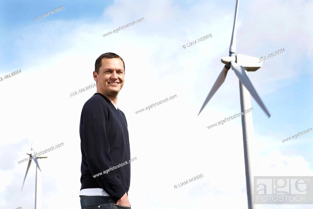 Stock Photo: Man on wind farm.