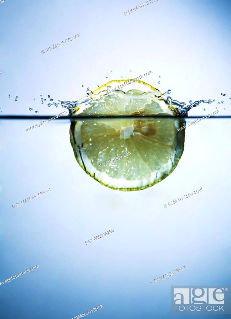 Stock Photo: lemon in water.
