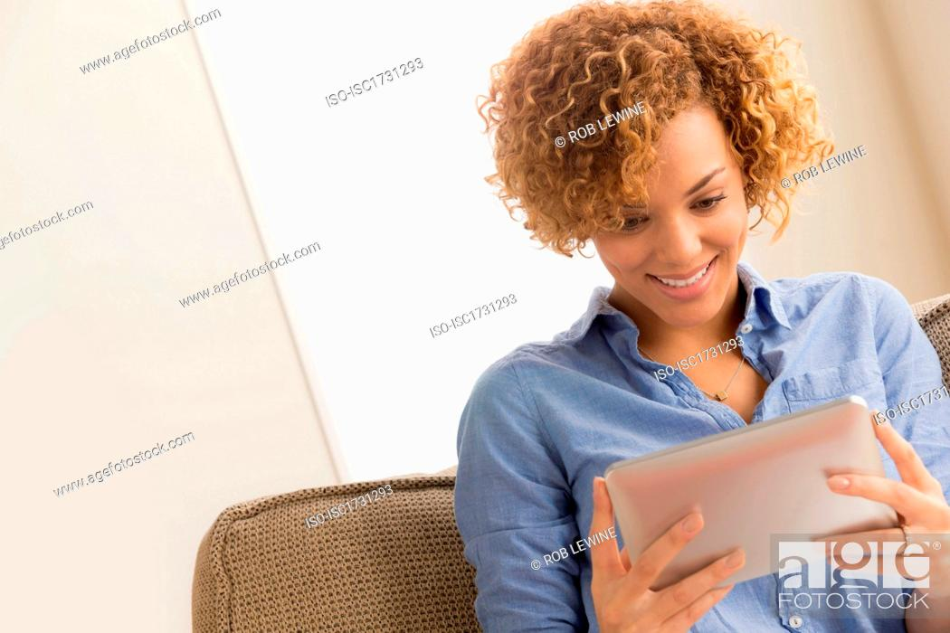 Stock Photo: Young woman with electronic book.