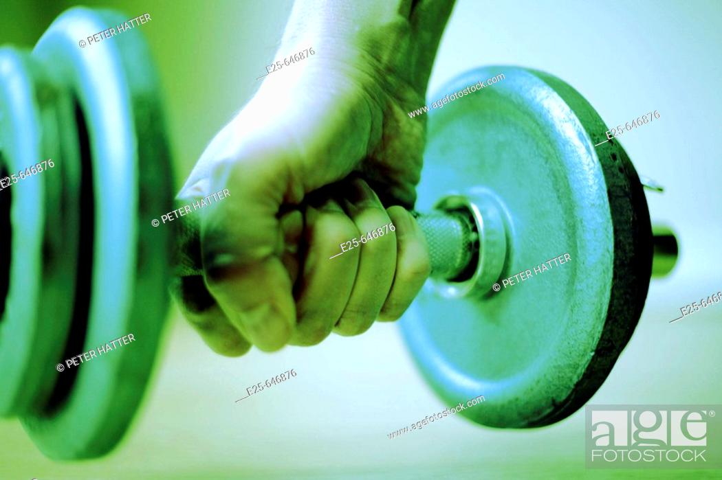 Stock Photo: Hand and dumbbell.