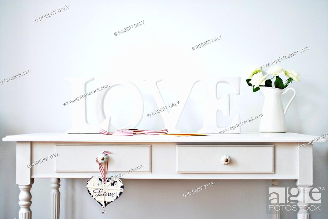 Stock Photo: Love decorations, ribbon, roses and card on desk.