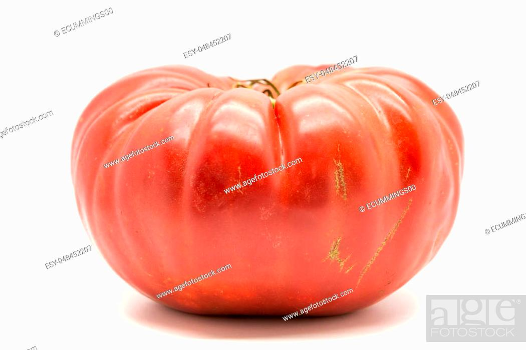 Photo de stock: Homegrown heirloom tomato isolated on white.