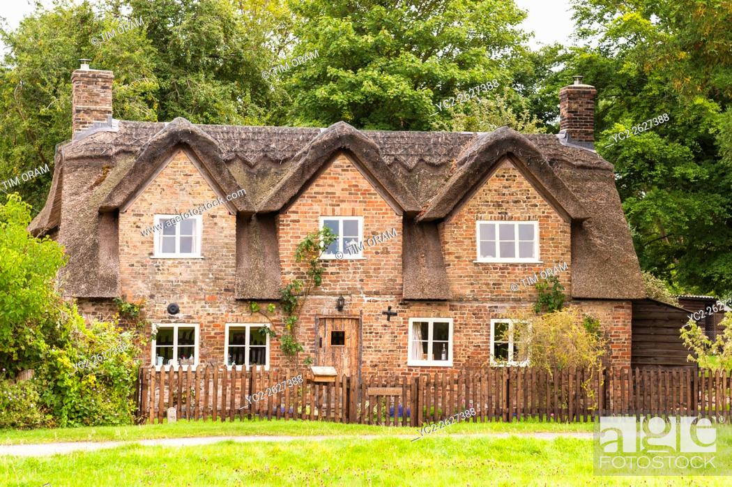 Stock Photo: A pretty thatched Cotswold cottage in Frampton-on-Severn , Gloucestershire , England , Britain , Uk.