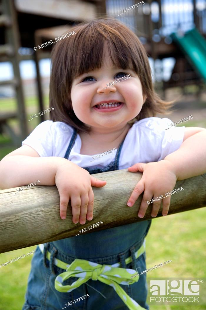 Stock Photo: Young girl in Playground.