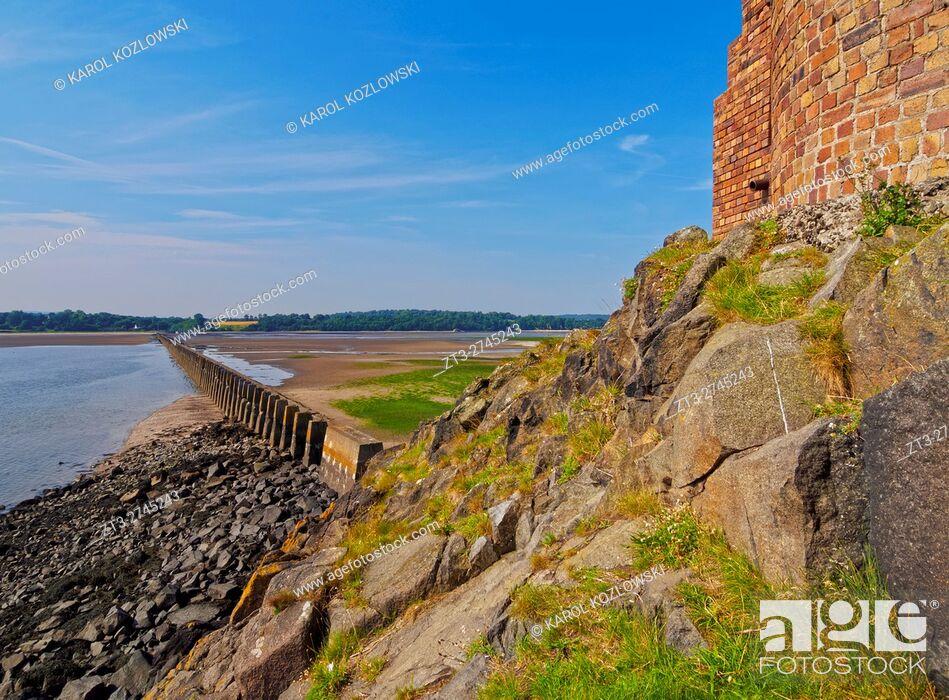 Stock Photo: UK, Scotland, Lothian, Edinburgh Area, Cramond, Causeway and Pylons leading to the Cramond Island at low tide. .