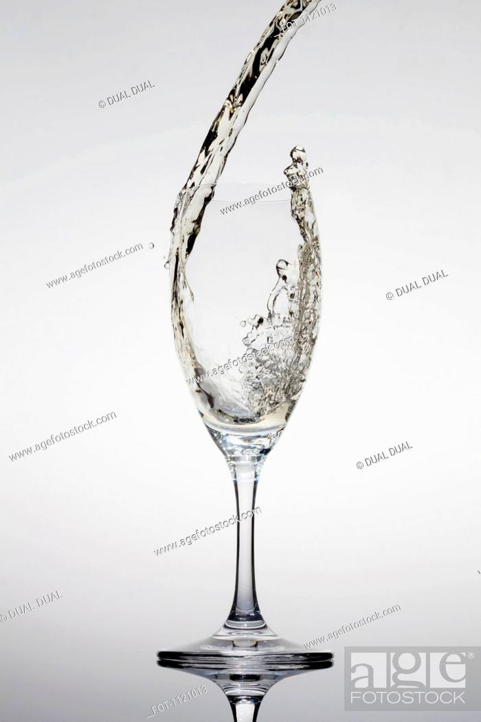 Stock Photo: Champagne being poured into a glass.