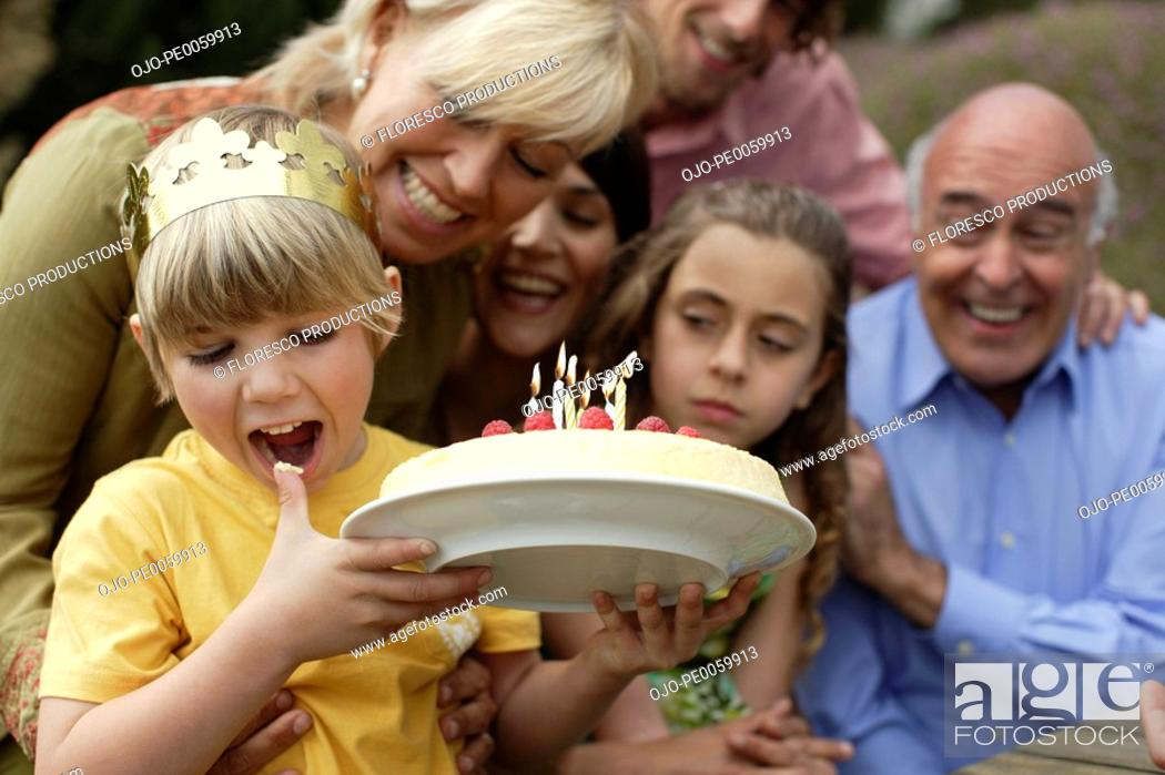 Stock Photo: Young boy celebrating birthday with family.