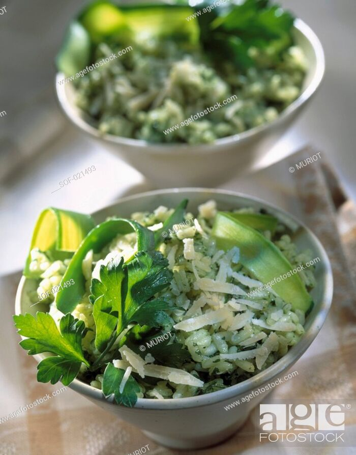 Stock Photo: Green risotto with courgette and parmesan.