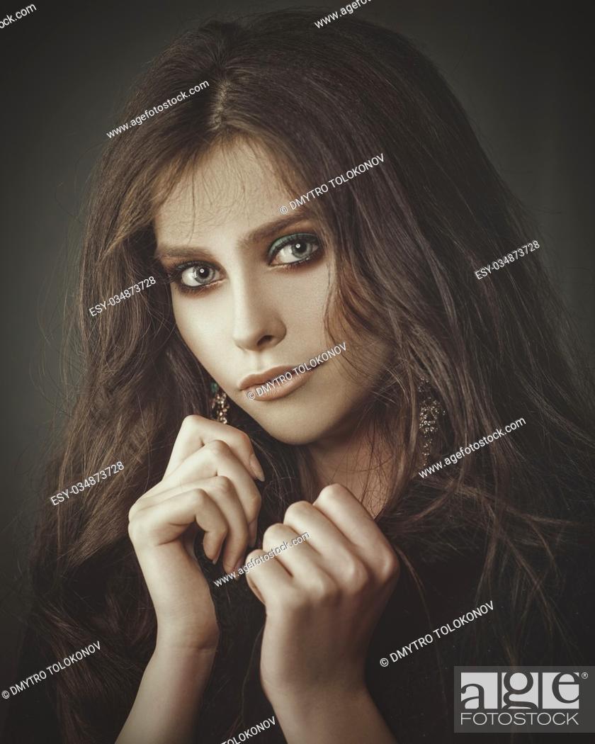 Stock Photo: Fashionable sepia toned romantic female portrait.