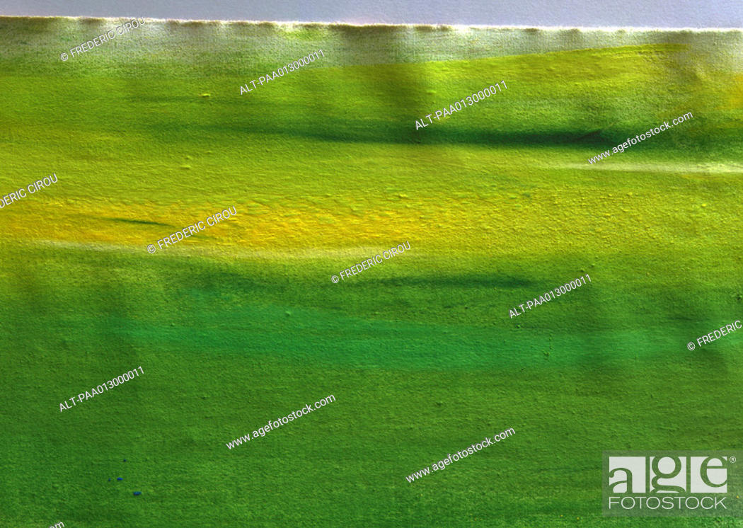 Stock Photo: Yellow and green paint on paper, full frame.