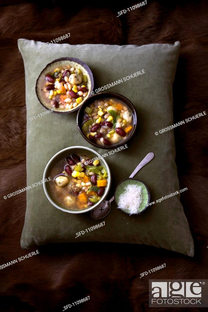 Stock Photo: Bean soup with sweetcorn and carrots.