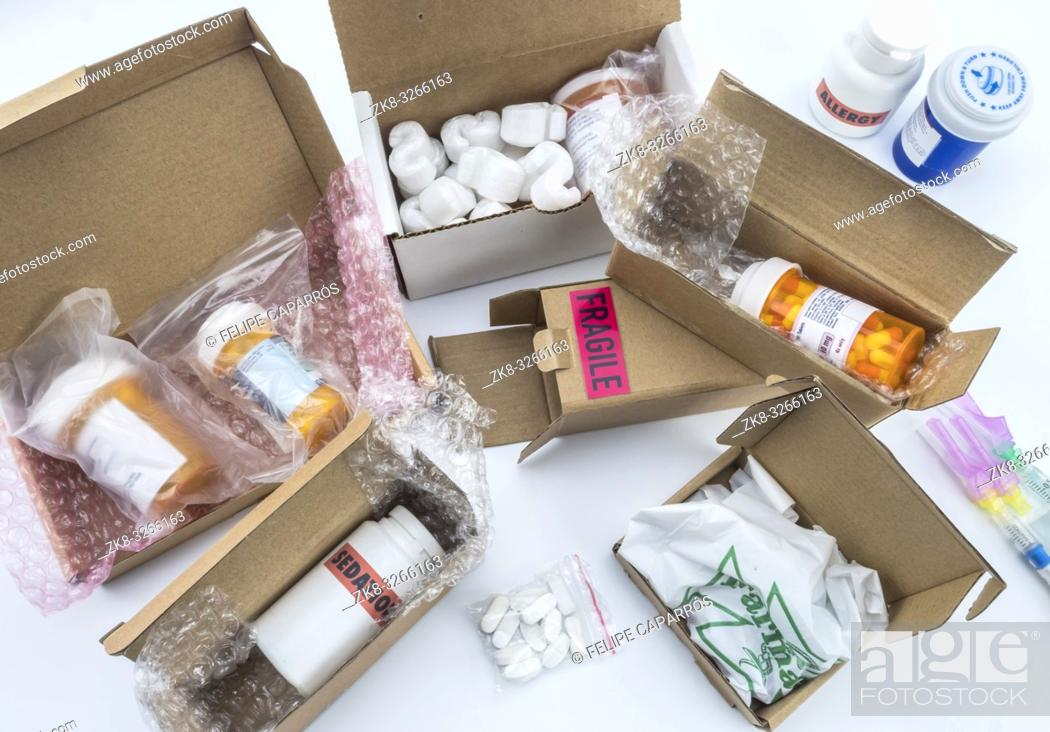 Stock Photo: unpacking medication in boxes, Diverse medicines in boxes for humanitarian aid, conceptual image.