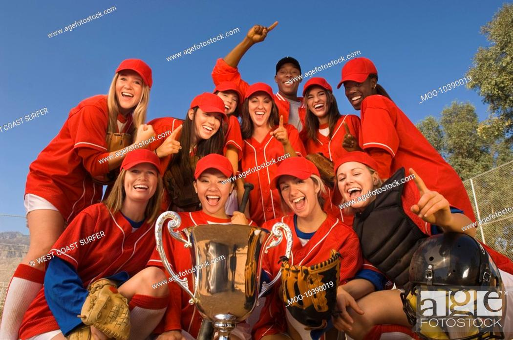 Stock Photo: Women's softball team with trophy portrait.
