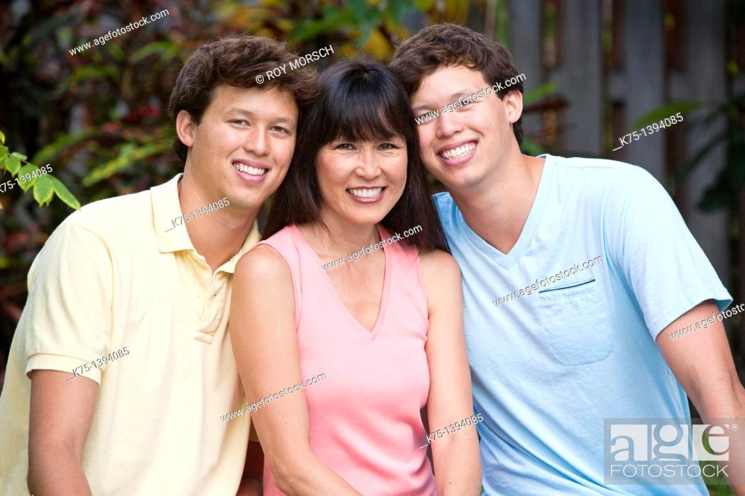 Stock Photo: Chinese American mom with her twin sons.