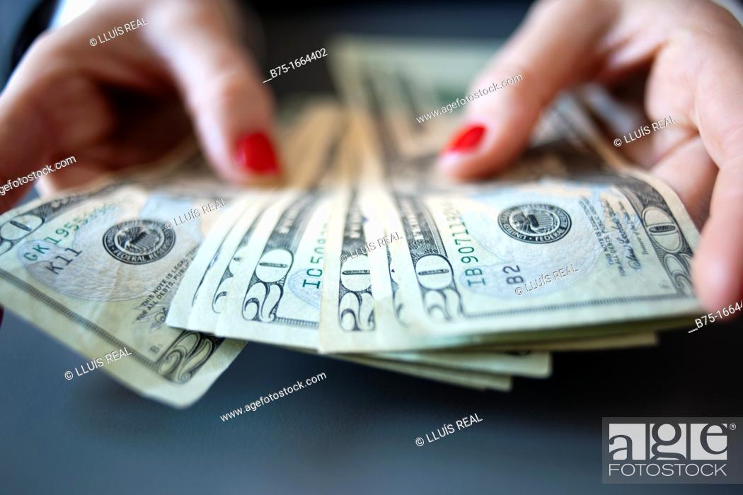 Stock Photo: Counting money.