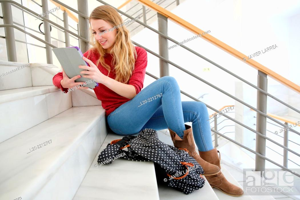 Stock Photo: Young female student with digital tablet at campus.