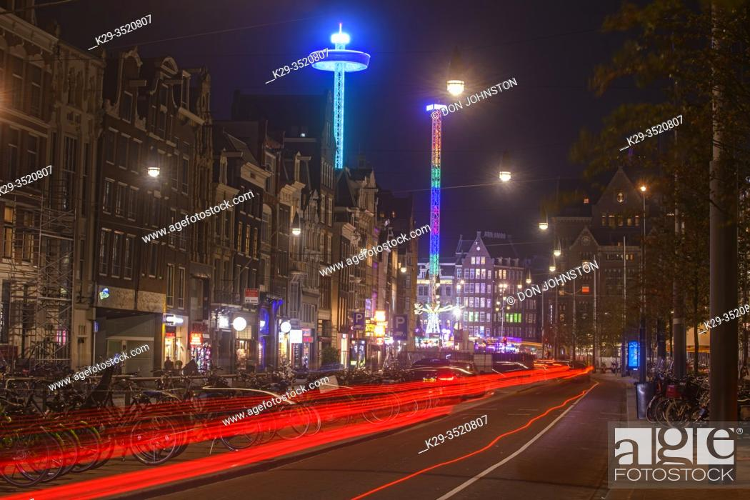 Stock Photo: Street scene (Damstraat) at night, Amsterdam, North Holland, Netherlands.