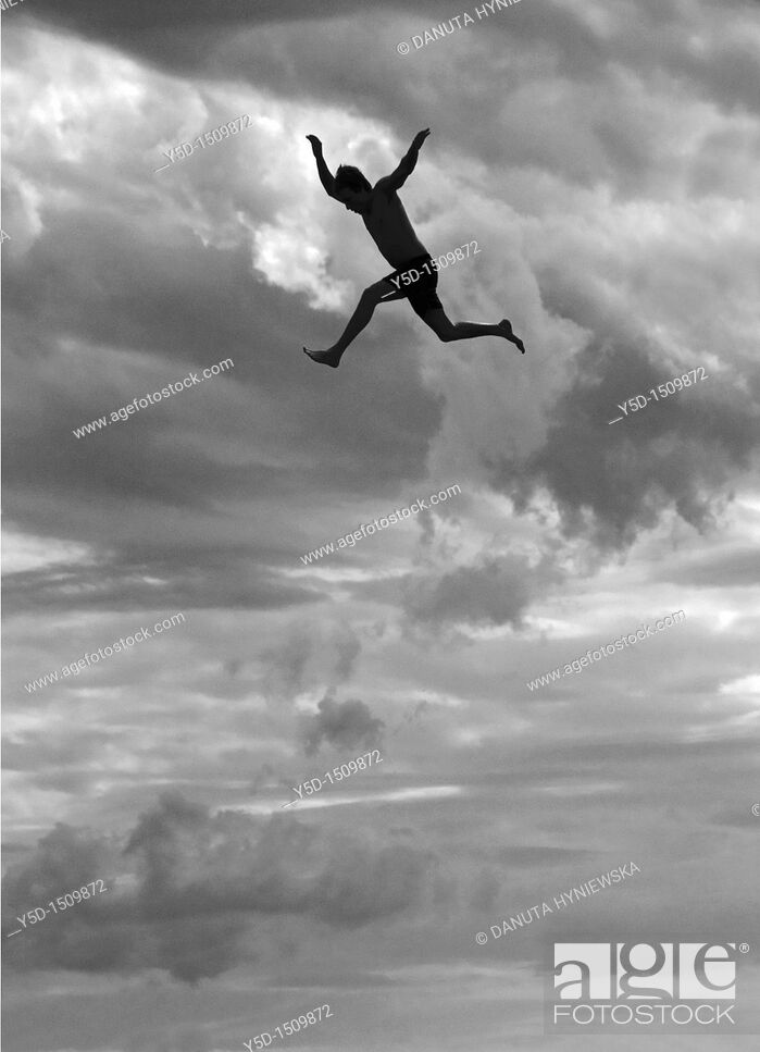 Stock Photo: young man jumping from the tower to the jumps in the water, beach on the Geneva Lake in Geneva called 'Paquis plage', Geneva, Switzerland.