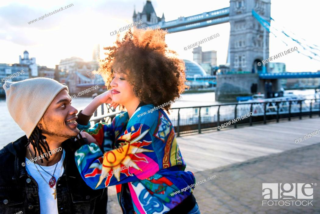 Imagen: Portrait of young couple outdoors, face to face, Tower Bridge in background, London, England, UK.