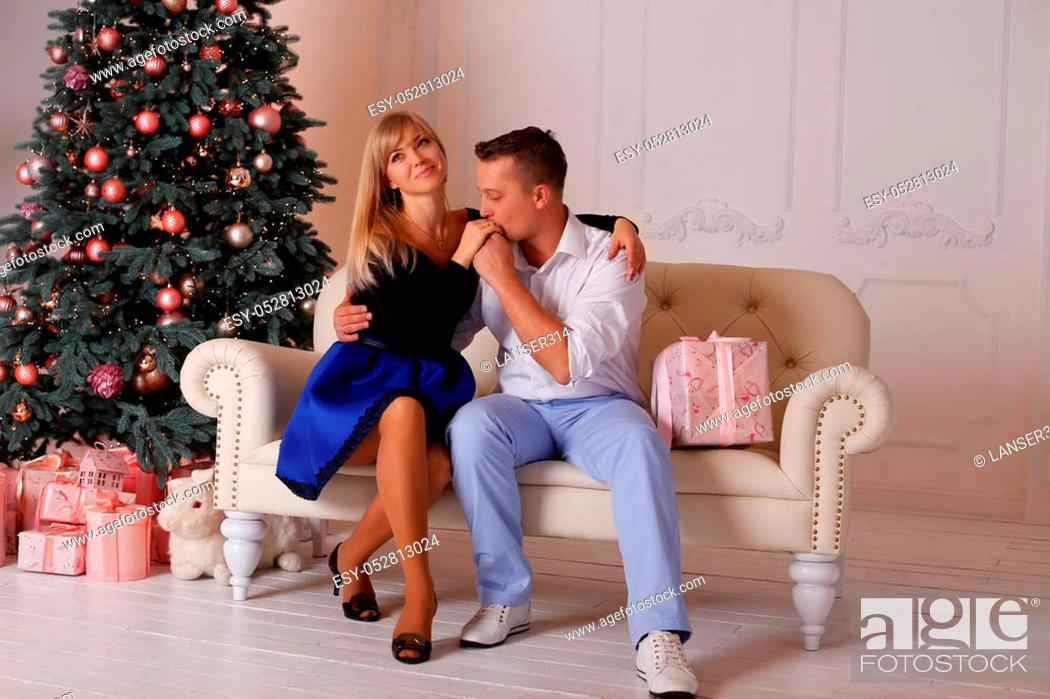 Stock Photo: The man and the woman near the Christmas tree on Christmas Eve.