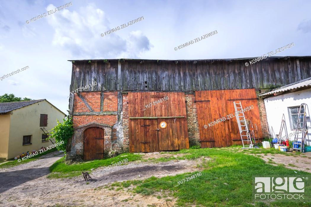 Stock Photo: Old barn on a farm in Gryfino County, West Pomeranian Voivodeship in Poland.