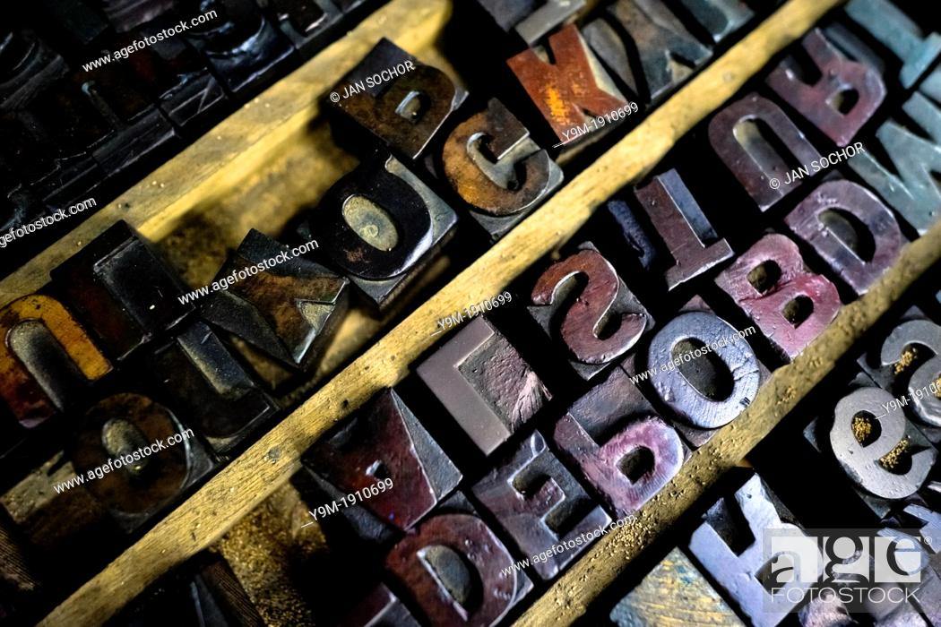 Stock Photo: Letterpress types, made of wood, placed in a tray in the vintage print shop in Cali, Colombia.