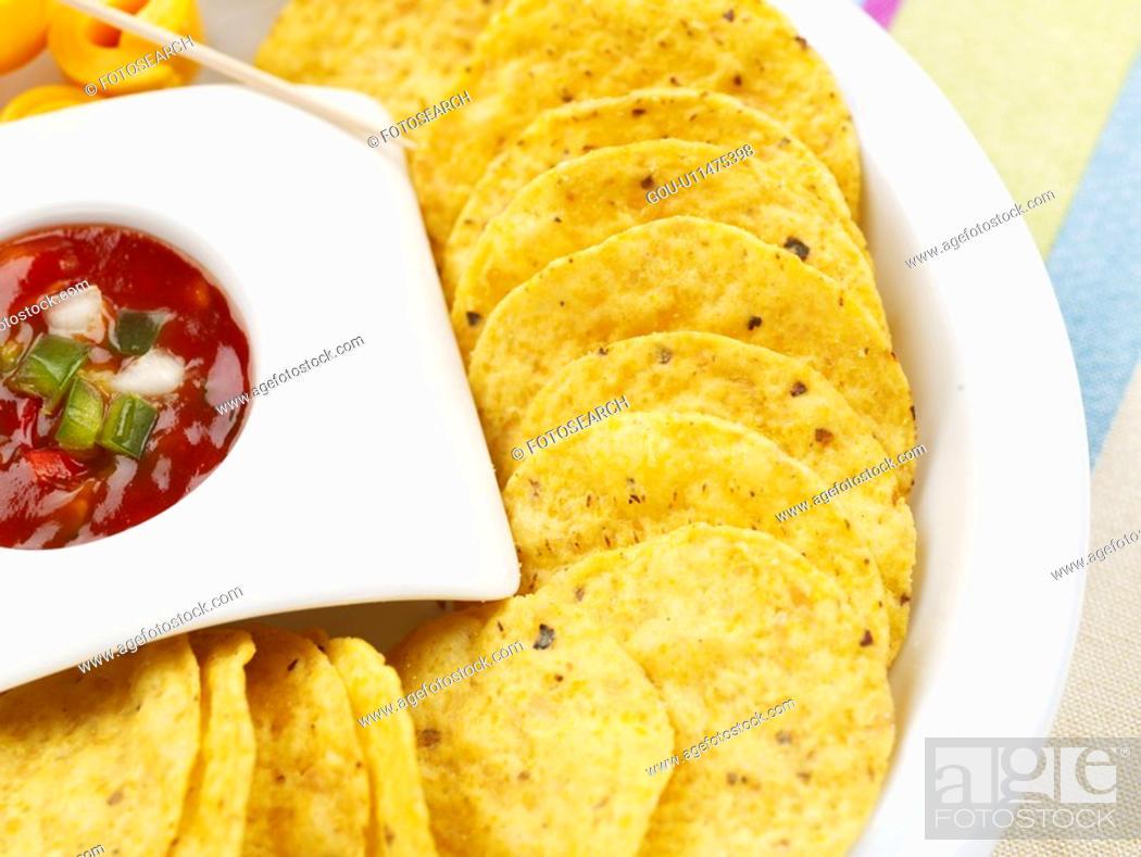 Stock Photo: food, chili sauce, decoration, food styling, tablecloth, cuisine, nachos.