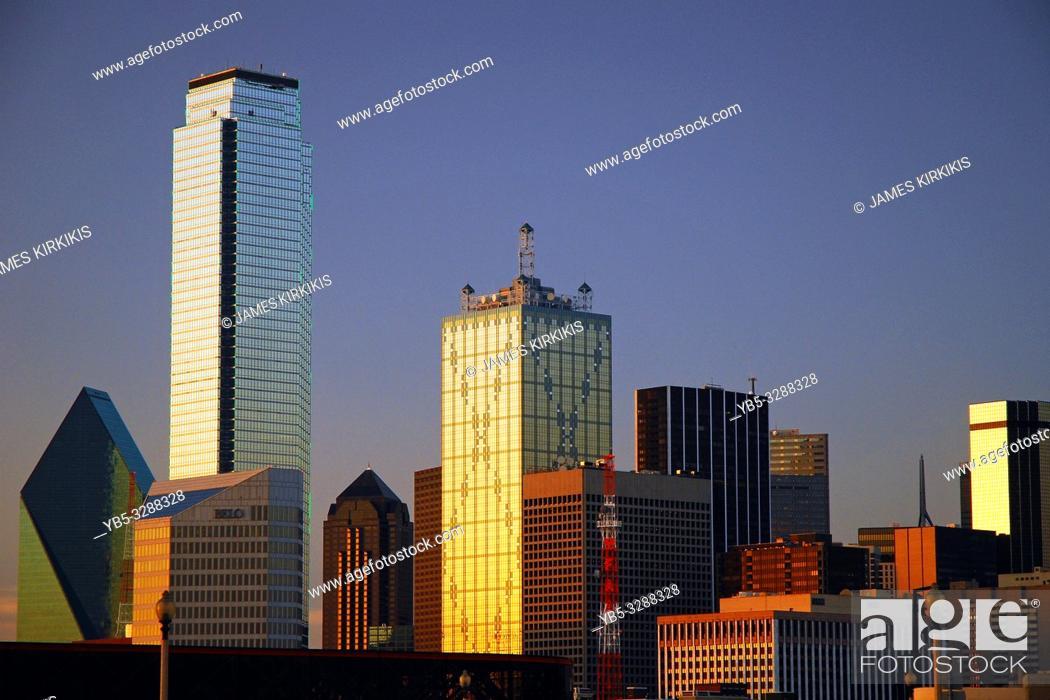 Stock Photo: Sunset glows on the windows of the Dallas skyline.