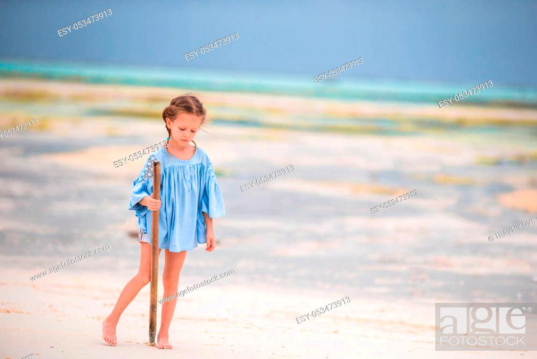 Stock Photo: Cute little girl in hat at beach during summer vacation.