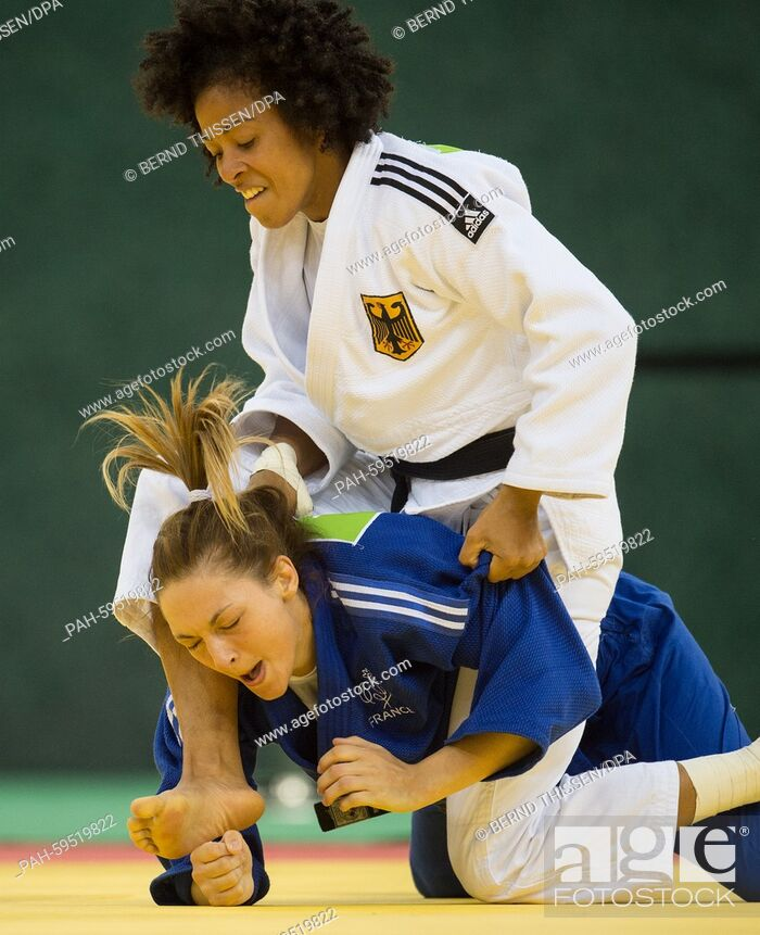 Stock Photo: Germanys Miryam Roper (white) competes with Pavia Automne of France in the Women's -57kg Judo Women's Bronze Final B at the Baku 2015 European Games in Heydar.