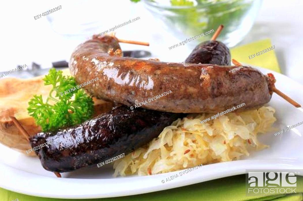 Stock Photo: Sausages, sauerkraut and baked potato.