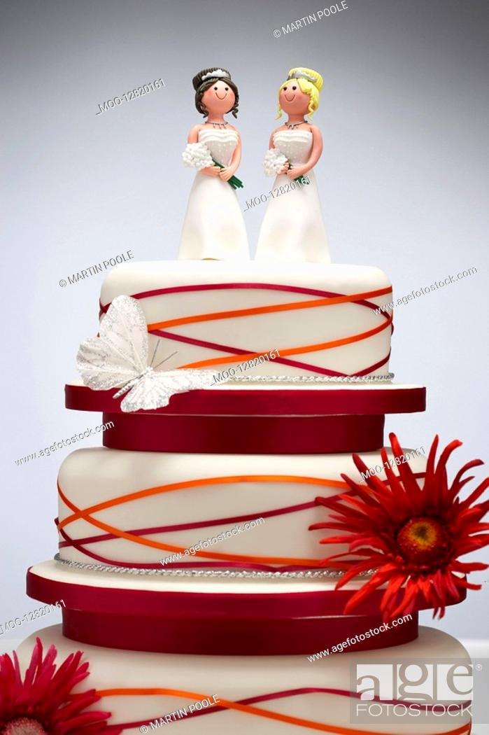 Stock Photo: Bridesmaid Figurines on Wedding Cake.