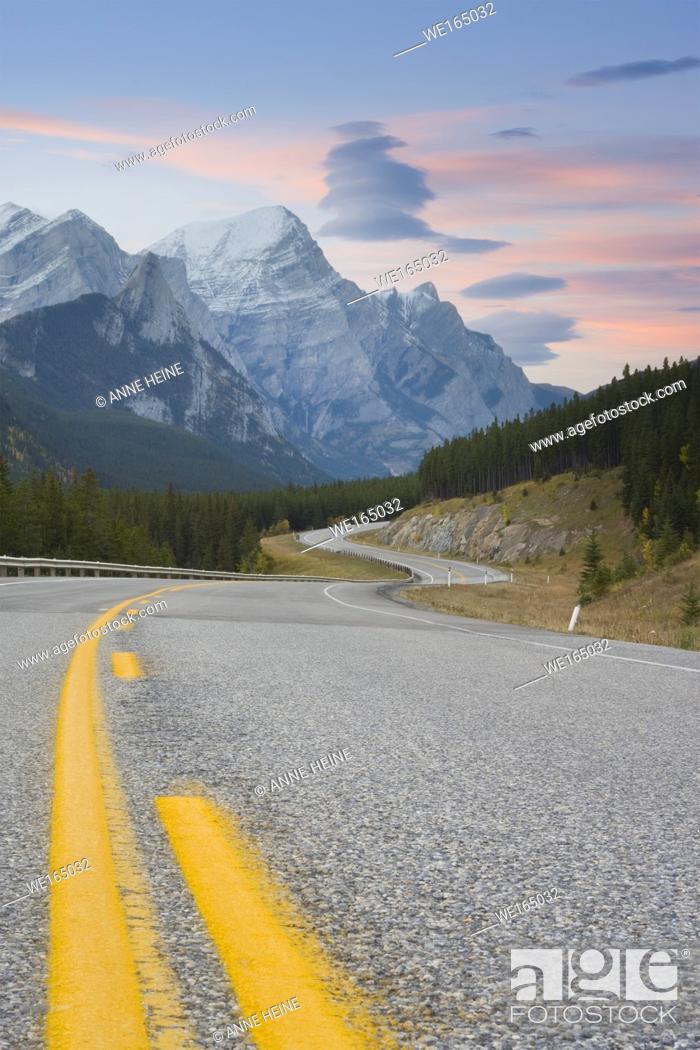 Stock Photo: curving road winding through Rocky Mountains, Kananaskis Country, Alberta, Canada.