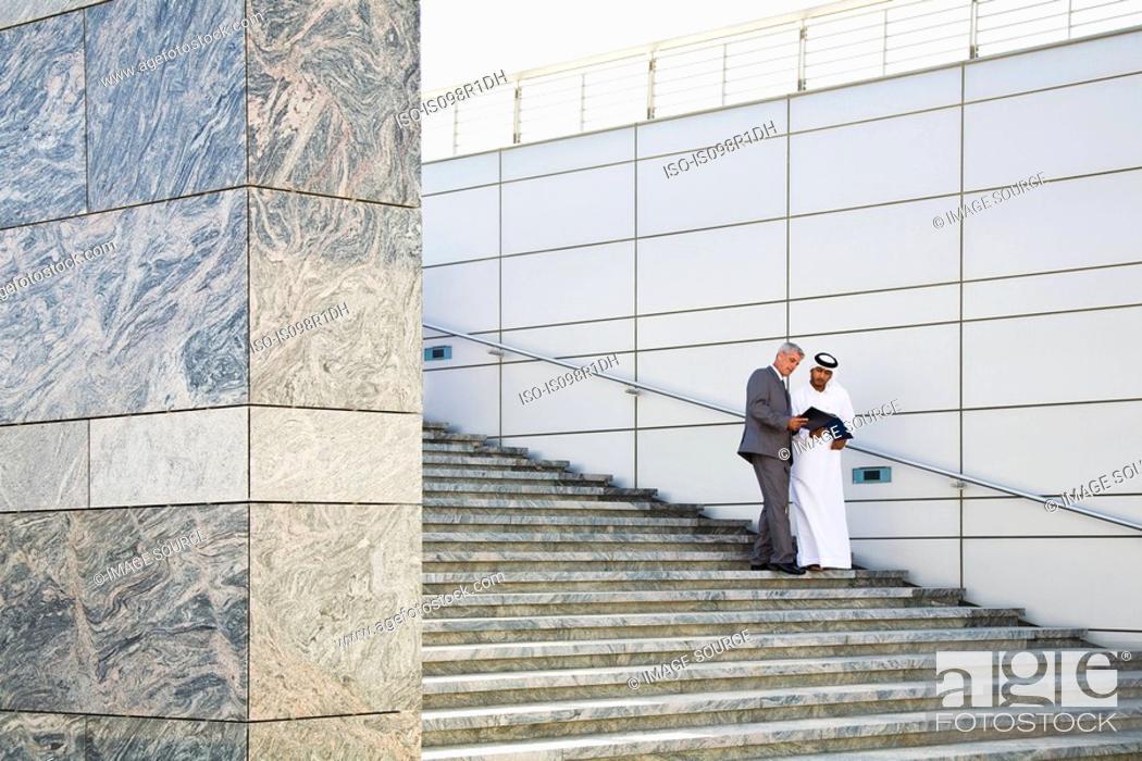 Stock Photo: Businessmen on steps.