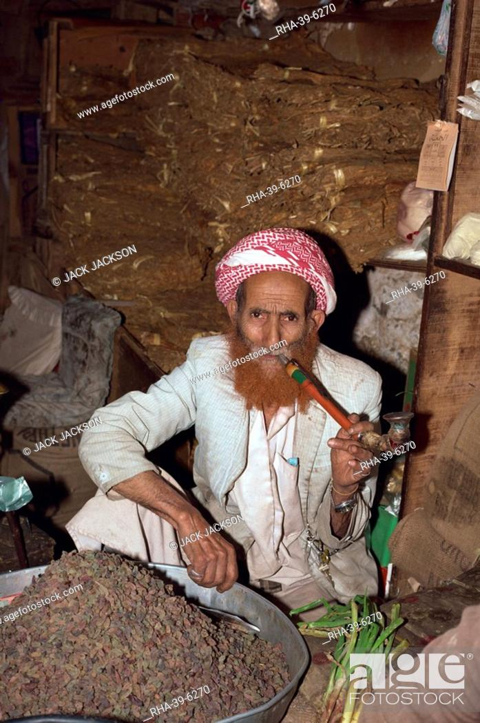Portrait Of An Elderly Shopkeeper With Henna Dyed Beard Smoking A