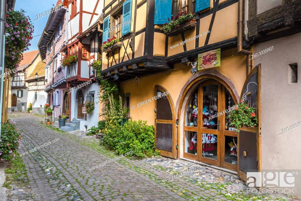 Stock Photo: lane with old houses in Eguisheim, Alsace, France, colorful timbered houses.