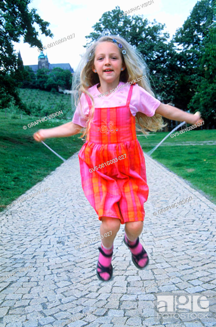 Stock Photo: Young girl skipping.