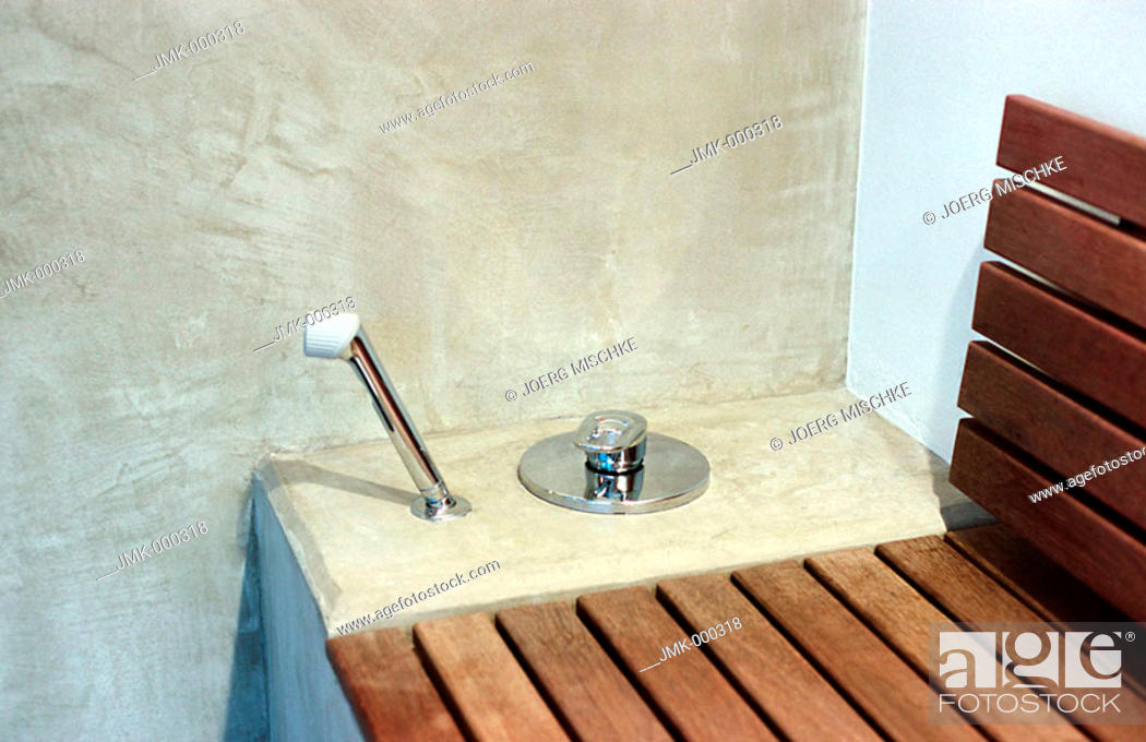 Stock Photo: Shower, hand shower and a wooden bench in a spa.