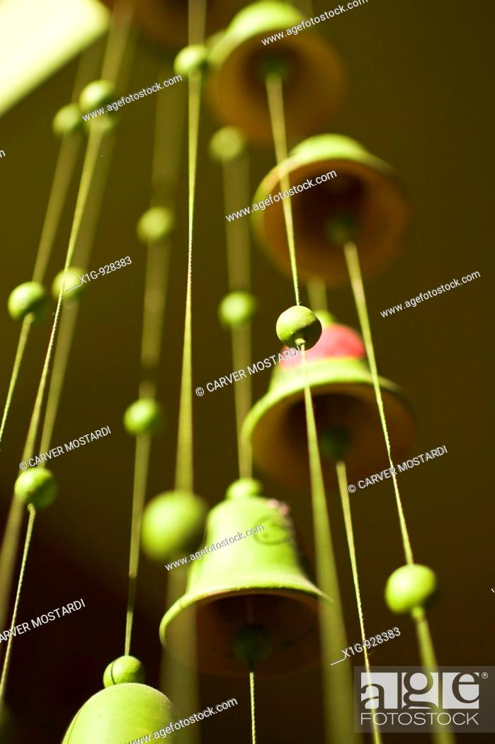 Stock Photo: Green bell wind chimes hanging in Casa Oro in San Juan del Sur, Nicaragua.