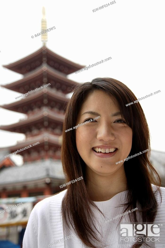 Stock Photo: Close-up of a smiling young woman.