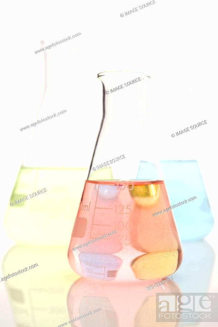 Stock Photo: Three volumetric flasks.